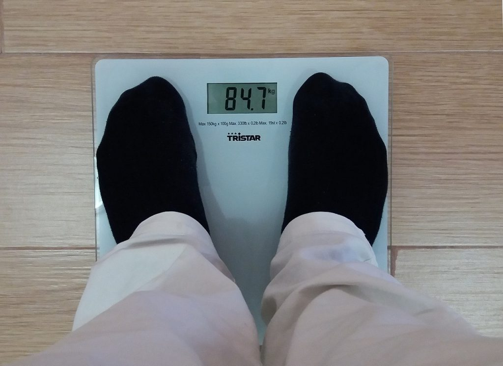 man weighing bmi
